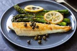 Lemon sole with butter and capers sauce and asparagus