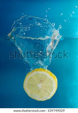 Lemon splashing into cold water