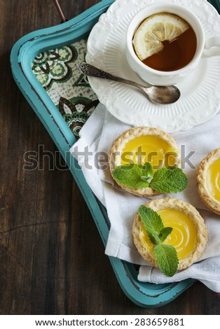 Lemon Tart and cup of tea. Top view #283659881