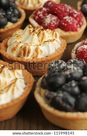 Lemon tarts and fruity tarts on a display