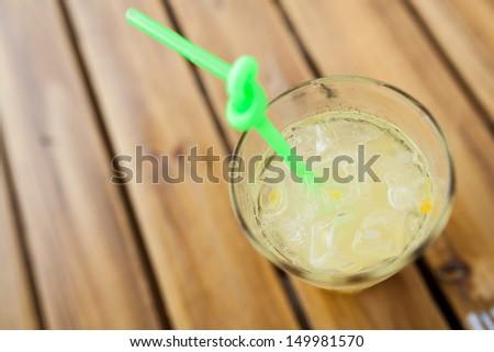 Lemon water in a glass bottle