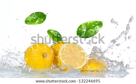 Lemon with water splash isolated on white