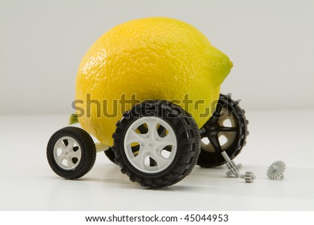 Lemon with wheels and car parts in breakdown