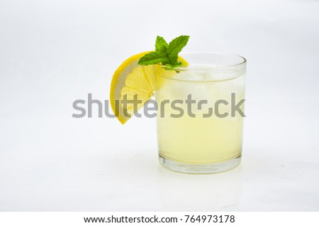 Lemonade. Lemon and mint drink in a glass with ice.