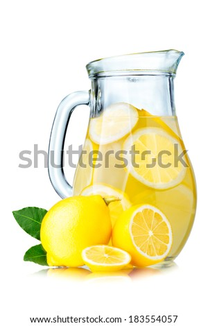 Lemonade pitcher with lemon slices and ice cubes isolated on white.