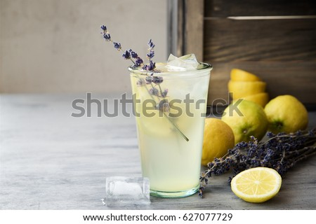 Lemonade with lemons and lavender on gray  shabby table.