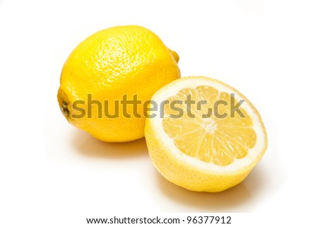 Lemons and Limes isolated on a white studio background.