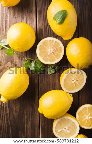 lemons  on a wooden background. ...