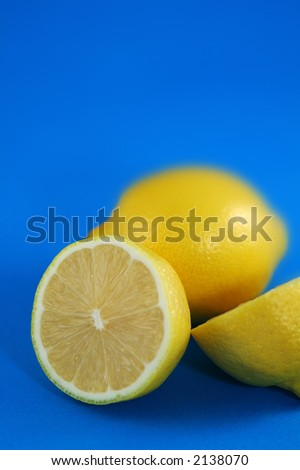 Lemons Over Blue Background. Shallow DOF.