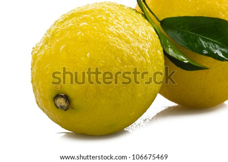 Lemons with drops close up  over white