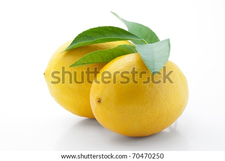 Lemons with leaves isolated on white with clipping path