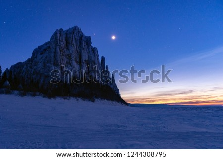 Lena Pillars at sunset and star night on the Lena river in the Natural Park Lenskie Stolby (Lena Pillars), Yakutia, Russia