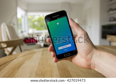 LENDELEDE, BELGIUM - MAY 24TH 2016: a male hand holding a Samsung mobile phone which displays the Twitter app. Illustrative editorial image.