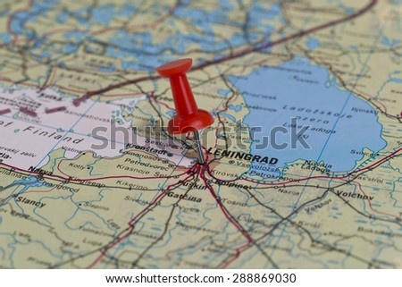 Leningrad (currently known as Saint Petersburg) marked with red pushpin on old USSR map. Selected focus on Leningrad and pushpin.