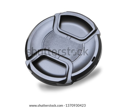 Lens cap for digital camera isolated over white #1370930423