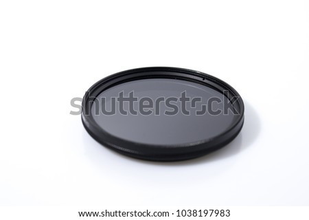 Lens filter reflex polarized filter in a white background composition #1038197983