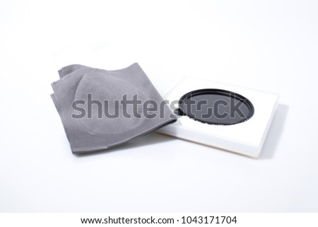 Lens filter reflex polarized filter in a white background composition #1043171704