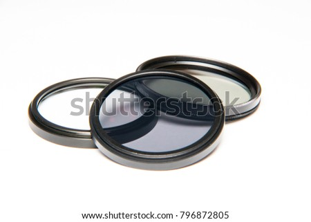 Lens filters isolated on white background. UV filter, CPL filter, ND filter. Canon and Nikon camera filter. #796872805