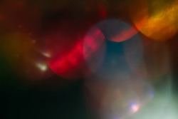 lens flare. colorful abstract. bokeh light on black background