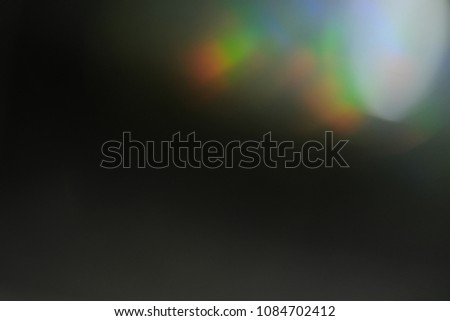 lens flare. colorful abstract. bokeh light on black background #1084702412