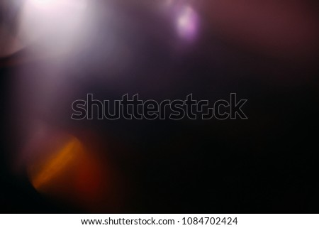 lens flare colorful abstract light glow black. optical abstract flash. black background #1084702424