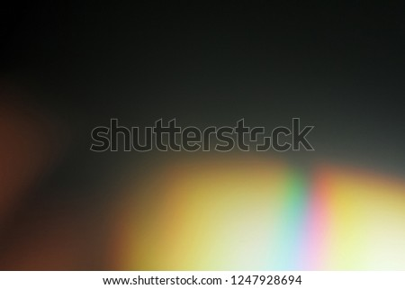 Lens flare effect. Photo using prism. Bottom right corner in rainbow illumination