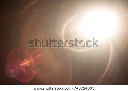 Photo of  Lens flare light over black background.