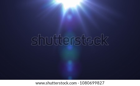 Lens flare light over black background. Easy to add overlay or screen filter over photos	 #1080699827