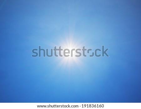 lens flare on blue sky background #191836160