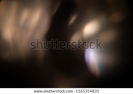 Photo of  Lens flare overlay texture on black background
