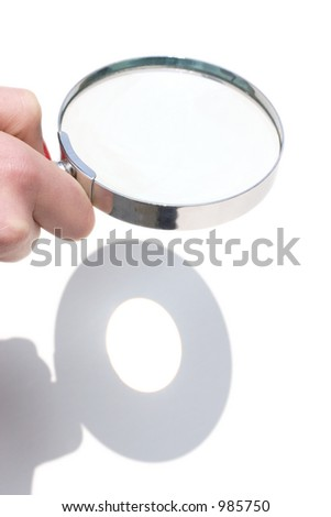 lens forming image of sun on paper - stock photo