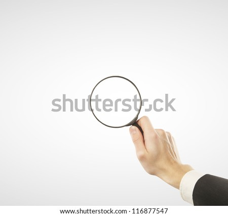lens in hand  on a white background