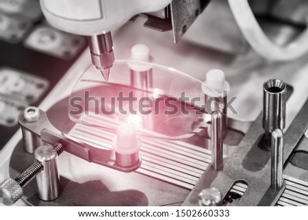 Lens manufacturing in modern laboratory.