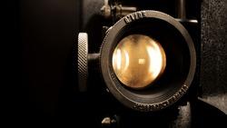 Lens of an old movie projector in close up view - macro shot