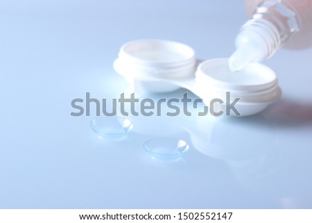 lenses for vision correction and a container for storing lenses. Contact lenses.