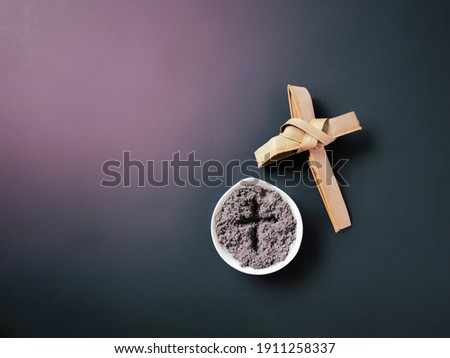 Lent Season,Holy Week and Good Friday Concepts - image of bowl of ash with cross made of palm leave background. Stock photo. Сток-фото ©