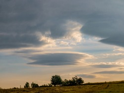 Lenticular cloud - Altocumulus lenticularis - strange cloud in the shape of a UFO in the sky