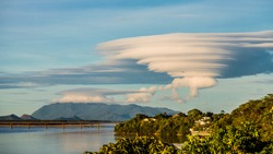Lenticular cloud formation above a typical mountain in northern Brazil, as view from the Boa Vista city (state of Roraima), at the right margin of the Rio Branco.