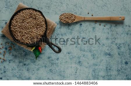 Lentil Beads. Lentil grains in bowl and spoon. #1464883406
