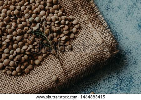 Lentil Beads. Lentil grains in bowl and spoon. #1464883415