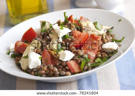 Lentil salad with chorizo, tomatoes, artichokes and feta
