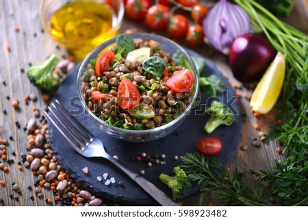 Lentil salad with veggies, healthy food, vegetarian and vegan snack, clean eating, diet, detox. Vegetables and cooking background #598923482