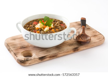 Lentil soup in a bowl, isolated on white background   #572563357