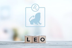 Leo star sign on a wooden table