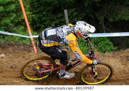 LEOGANG, AUSTRIA - JUN 12: UCI Mountain bike world cup. Cedric Gracia (FRA) at the downhill final race on June 12, 2011 in Leogang, Austria.