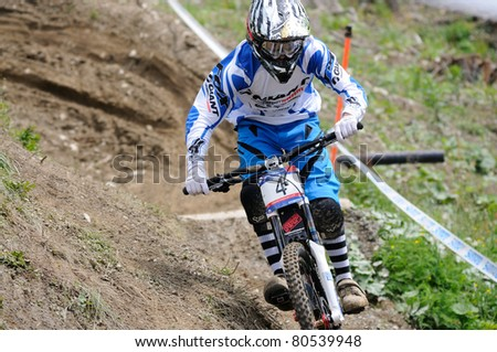 LEOGANG, AUSTRIA - JUN 12: UCI Mountain bike world cup. Danny Heart (GBR) at the downhill final race on June 12, 2011 in Leogang, Austria.