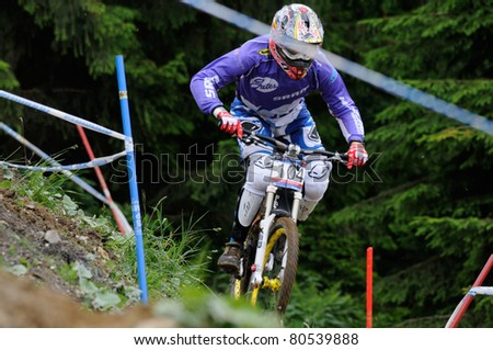 LEOGANG, AUSTRIA - JUN 12: UCI Mountain bike world cup. Participant at the downhill final race on June 12, 2011 in Leogang, Austria.