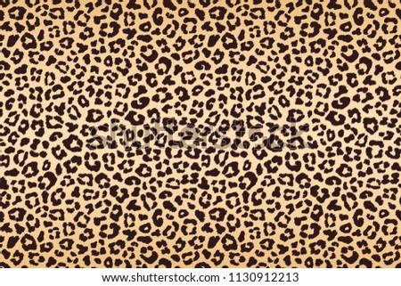 Leopard beige brown spotted fur texture. Raster version