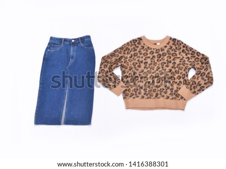 leopard pattern sweater with blue jeans skirt on white background