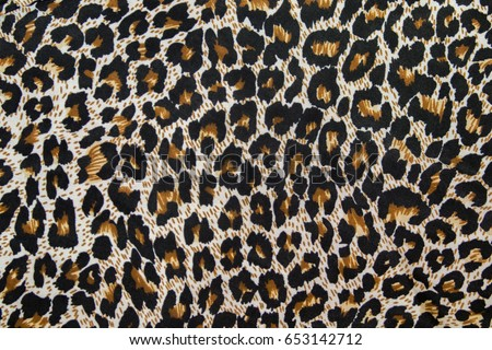 Leopard pattern texture. Textile, piece of clothes.